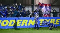 Just fan-tastic: Ian Parkhill celebrates his opener with the travelling Coleraine support last night
