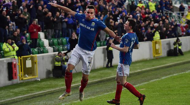Linfield's Andrew Waterworth scores during this afternoon's game at Windsor Park. Photo Charles McQuillan/Pacemaker Press