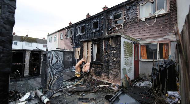 General view of the scene in Church Avenue, Dundrum, County Down where at least one house has been destroyed in a fire . Photo by Kelvin Boyes / Press Eye