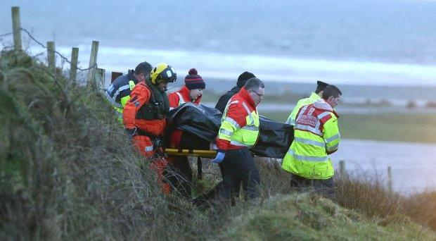 Members of the Gardai and order of Malta recover a body after an suv entered the a river in the Carrowniskey area of Louisburgh, Co. Mayo. Picture credit; Damien Eagers 25/12/2017