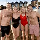 Swimmers at the SPARKS NI Annual Boxing Day Swim at Ballyholme sailing club in Bangor. Shane ,Sara and Emily Murray and Rafa Cuise. Mandatory Credit /Stephen Hamilton-Presseye