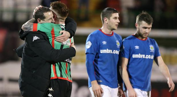 Glentoran manager Gary Haveron celebrates with William Garrett at the final whistle. Pic: INPHO/Brian Little