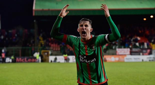 Feeling blue: Glentoran captain Marcus Kane celebrates his side's 2-1 win over Linfield yesterday