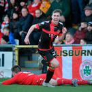 Breakthrough: Gavin Whyte sets off in celebration after putting Crusaders in front at Seaview