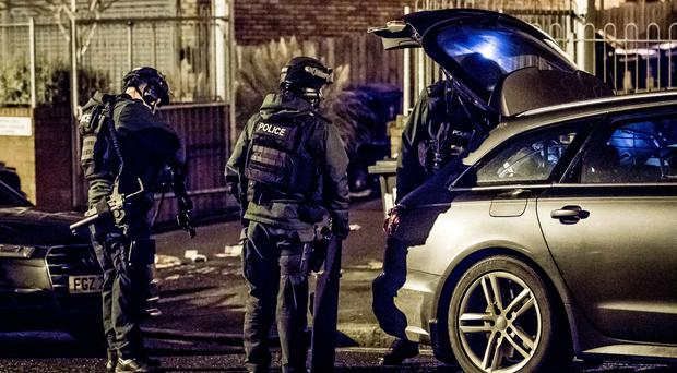Armed Response officers deal with an incident at a block of apartments on the Whitewell Road (Photo by Kevin Scott / Belfast Telegraph)