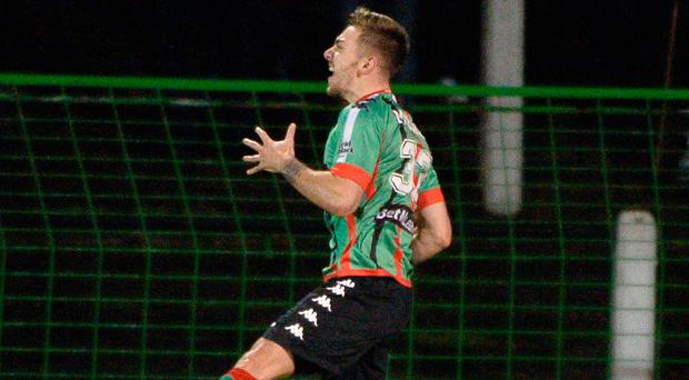 Hitting the heights: Robbie McDaid celebrates Glentoran's winner against Linfield