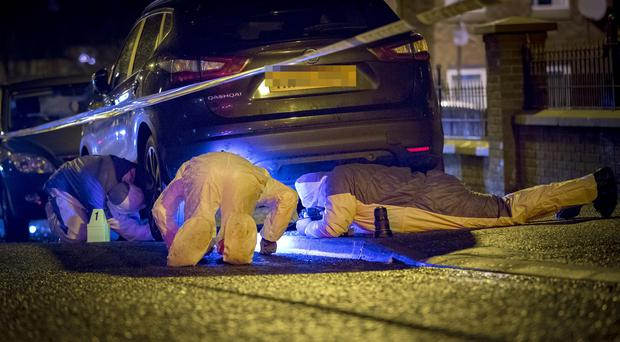 Police and forensics at the scene of a hammer attack in the Springhill area of west Belfast on December 29th 2017 (Photo by Kevin Scott / Belfast Telegraph)