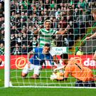 Rangers Wes Foderingham saves on the line with Celtic's Scott Sinclair and Rangers James Tavernier looking on