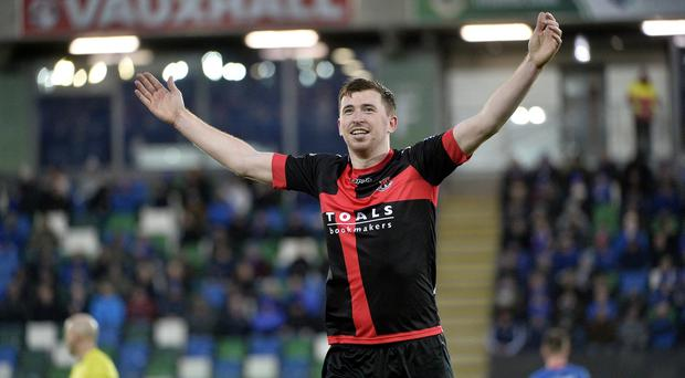 Crusaders' Billy Joe Burns celebrates levelling the scores at Windsor Park.