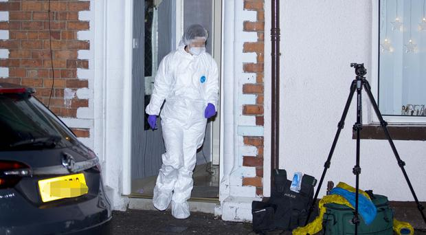 Police and forensics at the scene of a shooting in a house on Cavendish Street in west Belfast on December 30th 2017 (Photo by Kevin Scott / Belfast Telegraph)
