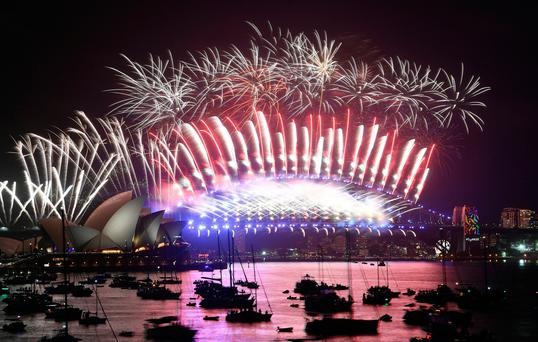 Fireworks light the sky over the Opera House and Harbour Bridge during New Year's Eve celebrations in Sydney early on January 1, 2018. / AFP PHOTO / SAEED KHANSAEED KHAN/AFP/Getty Images