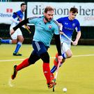 Attack mode: Belfast Harlequins ace Michael McKenna takes on Queens at the weekend