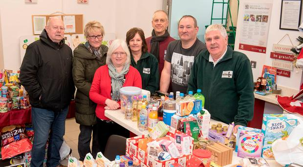 Denis McGowan from Foyle food bank (left) with volunteers Jacinta McCanny, Deirdre O'Kane, Kathleen McCamphill, Eddie Sheehy, Sean Moore and Pat Doran