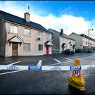 Crime tape surrounds the scene of the fatal stabbing in the village of Ballyjamesduff, Co Cavan