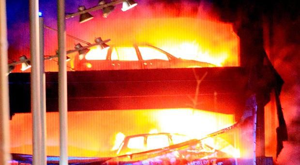 Vehicles burn at a multi-storey car park next to the Echo Arena in Liverpool