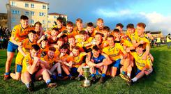 Party time: Enniskillen Gaels celebrate with the Ulster minor club trophy in west Belfast yesterday