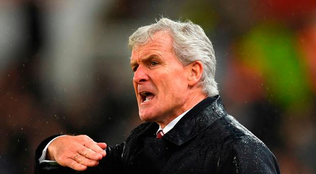 Under fire: Mark Hughes's future at Stoke is unclear