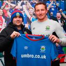 Geared up: David Healy unveils Achille Campion as Linfield's latest recruit at Windsor Park