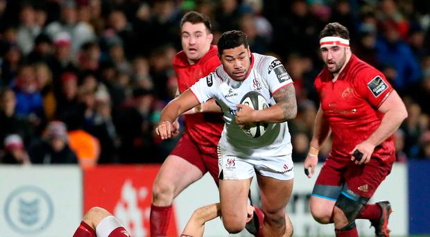 Charging through: Charles Piutau takes on Munster during Ulster's comeback