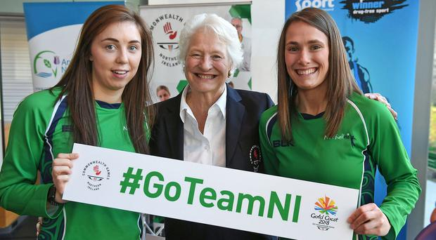 Netball stars Fionnaula Toner (left) and Niamh Cooper (right) join Dame Mary Peters at the Commonwealth Games TeamNI announcement for Gold Coast 2018.