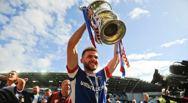 Major lift: Stephen Lowry wants a repeat of last May when Linfield clinched Irish Cup glory