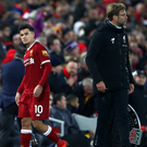 Decisive: Philippe Coutinho after being substituted by Liverpool boss Jurgen Klopp (right) last week