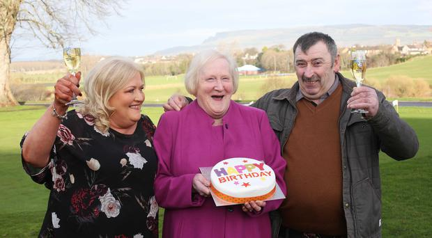 MUMS THE WORD FOR LUCKY LOTTERY WINNER: Roisin McNicholl from Dungiven has become Northern Irelands latest lottery winner after scooping a whopping £285,288.60 in the Euromillions draw on Tuesday December 19. Roisin was out buying a gift for her mothers birthday when she decided to buy a Lucky Dip which turned out to be the winning ticket! Roisin celebrated the big win with her family at the Roe Park Resort in Limavady. Roisin is pictured with her husband Martin and her mum Ellen Bradley.