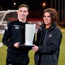 Top man: Crusaders midfielder Gavin Whyte with Portia Long from BetMcLean after claiming the December Player of the Month award from the Northern Ireland football writers