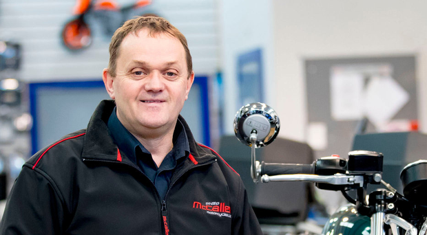 In the hotseat: Phillip McCallen at his dealership in Lisburn