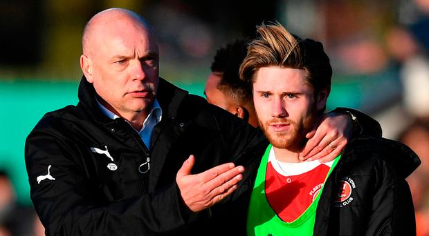 Drawing comfort: Uwe Rosler, manager of Fleetwood Town, congratulates Wes Burns after the draw with Leicester City