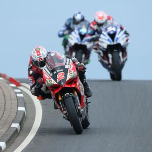Need for speed: Glenn Irwin leads Alastair Seeley and Ian Hutchinson at the NW200