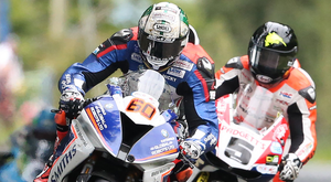 Peter Hickman and Bruce Anstey lock horns at the Ulster Grand Prix