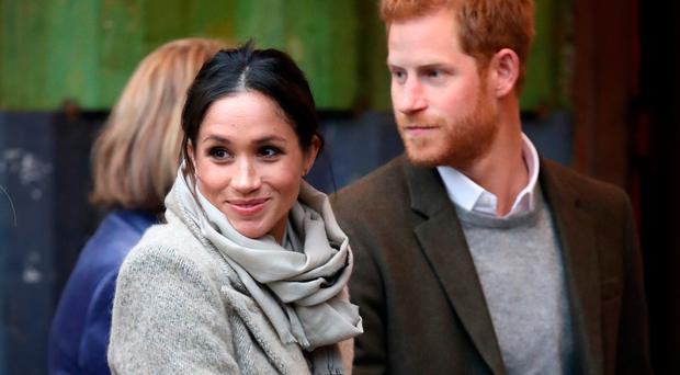 Prince Harry (R) and his fiancee Meghan Markle visit Reprezent 107.3FM on January 9, 2018 in London, England. (Photo by Chris Jackson/Getty Images)