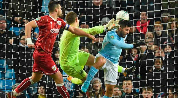 Head boy: Sergio Aguero nets Man City's winner in the 2-1 victory over Bristol City