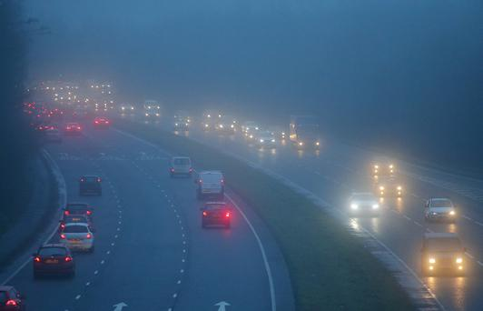 Motorists make their way along the Bangor to Belfast carriageway as heavy fog covers Belfast. Picture by Jonathan Porter/PressEye