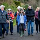 Michael's sister Cathy, cousin Niall and (far right) brother Daniel, as family and friends of the missing man, assisted by CRS (Community Rescue Service), carry out searches in the Cave Hill area