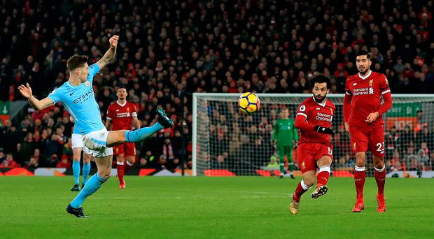 Liverpool's Mohamed Salah scores his side's fourth goal of the game during the Premier League match at Anfield Credit: Peter Byrne/PA Wire