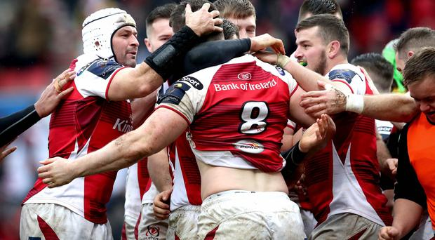 Ulster players surround Nick Timoney to celebrate his try during the 20-13 win over La Rochelle.