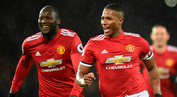 Main man: Antonio Valencia wheels away to celebrate with United team-mate Romelu Lukaku after scoring