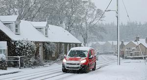 A Royal Mail van battles through snowy conditions. Pic: Andrew Milligan/PA Wire