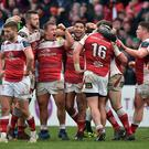 Ulster players celebrate victory at the final whistle on Saturday.