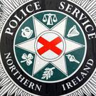 A suspected machine gun has been found in an abandoned car in Lurgan.