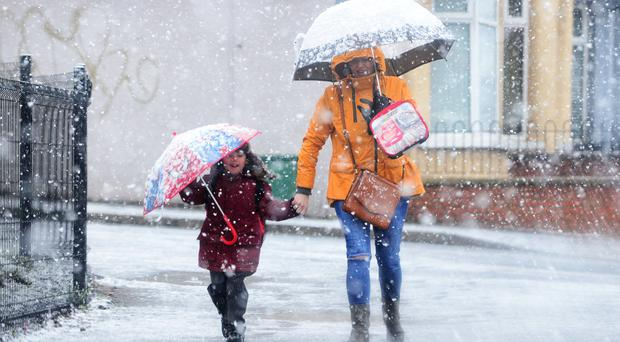 Heavy snow has caused widespread travel disruption in Northern Ireland, with bus and rail services affected and some roads closed / Credit: Pacemaker .