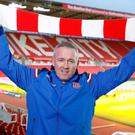 Paul Lambert poses with a Stoke scarf