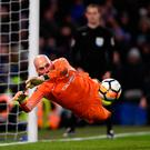Safe hands: Chelsea keeper Willy Caballero saves a penalty from Norwich's Nelson Oliveira in the shoot-out at Stamford Bridge last night