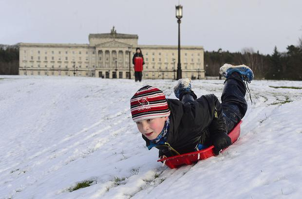 Heavy snow caused widespread disruption across Northern Ireland. Jacob McKeown (9) from Belfast pictured enjoying the snow at Stormont. Picture By: Arthur Allison Pacemaker .