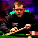 On cue: Mark Allen en route to knocking Ronnie O'Sullivan out of the Masters