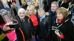 Derek Kernaghan and Janet Armstrong from Bangor, Stanley and Esther Quigg from Antrim take a selfie with TV celebrity Anthea Turner who opened the Belfast Telegraph Holiday World Show.