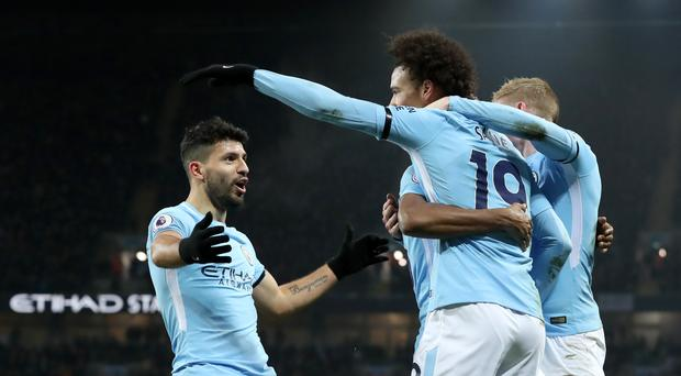 Sergio Aguero (left) scored a hat-trick against Newcastle