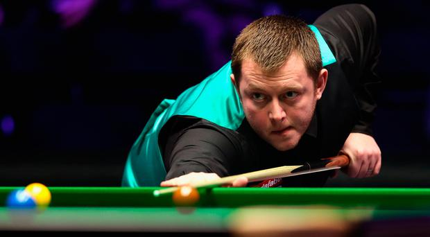 Mark Allen plays a shot during The Dafabet Master Final against Kyren Wilson